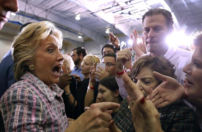 <p>Hillary Clinton greets supporters during a campaign rally at Coral Springs Gymnasium on September 30, 2016 in Coral Springs, Florida. Hillary Clinton is campaigning in Florida. (Justin Sullivan/Getty Images) </p>