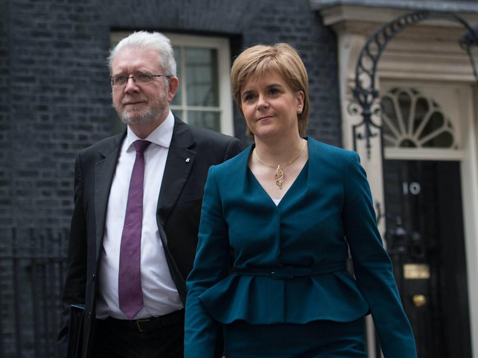 Scotland's constitution secretary Michael Russell with Nicola SturgeonPA