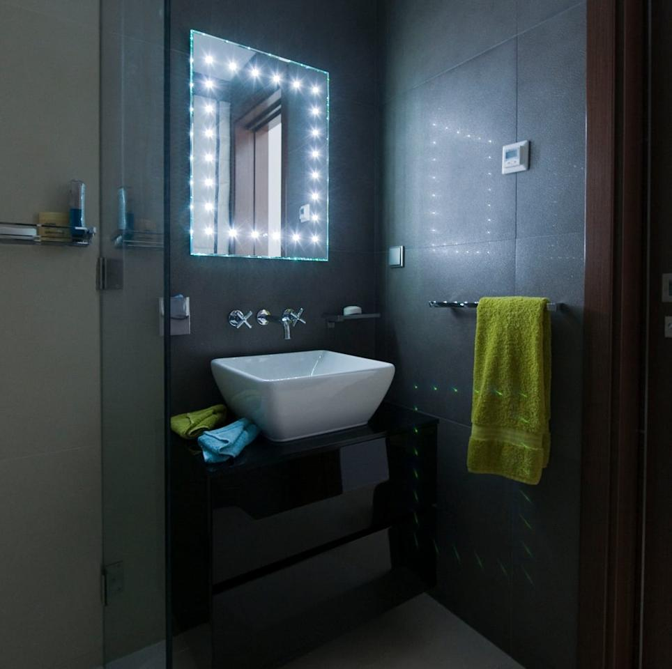 <p>Having a small bathroom shouldn't cramp your enthusiasm for exploiting unusual or dramatic design touches and actually, if you get them right, they can distract entirely from modest dimensions, which is why we chose this specific image to represent out point.</p><p>There's so much that should be wrong here. Dark walls, gimmick lighting and neon-bright towels should all spell a claustrophobic disaster for this tiny bathroom but instead, the observer simply gets dazzled by how stylish, different and daring the scheme is. The light-up mirror almost seems to hypnotise onlookers into forgetting the size of the room, which is genius bathroom design at its best.</p>  Credits: homify / Cheryl Tarbuck Design