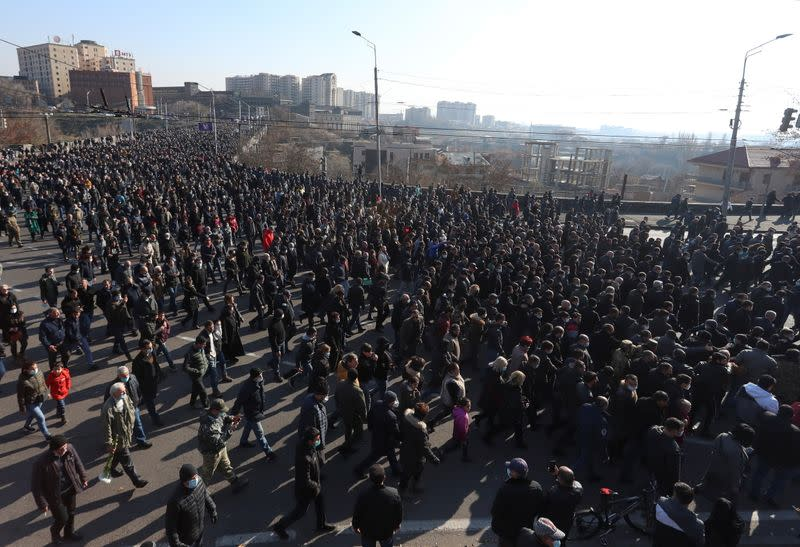 People take part in a procession marking the Armenian nationwide mourning in Yerevan