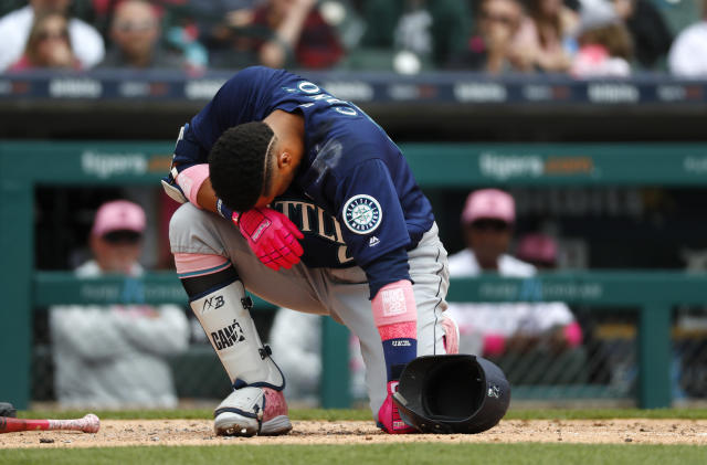 Seattle Mariners' Robinson Cano (22) reacts after being hit on the hand by a Detroit Tigers relief pitcher Blaine Hardy pitch in the third inning of a baseball game in Detroit, Sunday, May 13, 2018. (AP Photo/Paul Sancya)