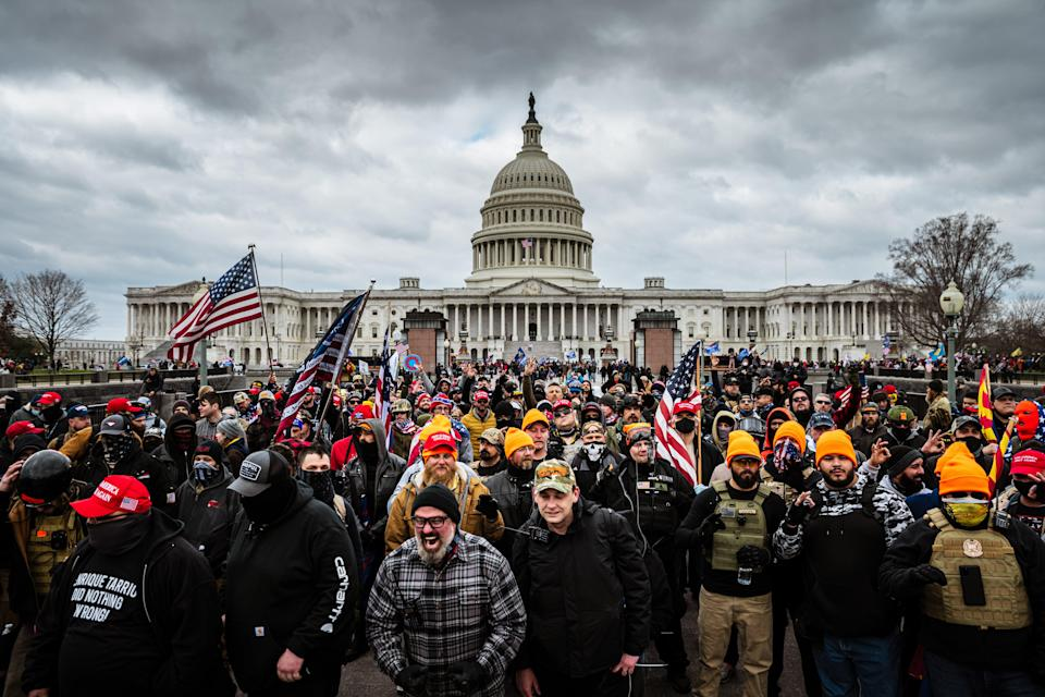 <p>Proud Boys wanted to incite 'normies' at Capitol riot to 'smash some pigs to dust', court filings claim</p> (Photo by Jon Cherry/Getty Images)