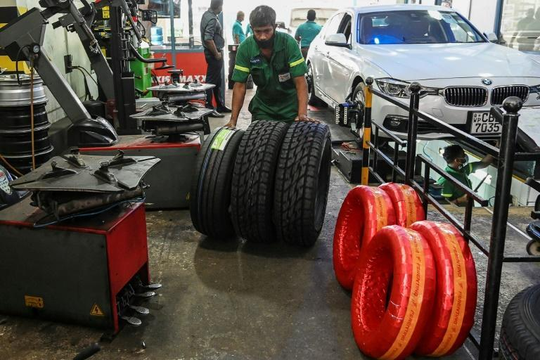 Workers check tyres at a repair shop in Colombo. Foreign-made tyres are also in short supply in Sri Lanka