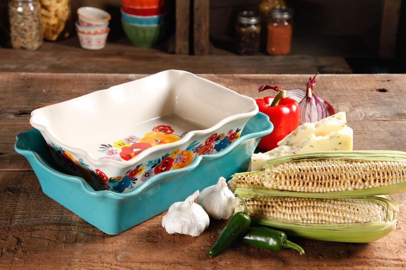 """<p>Baking will be a pleasure with this two-piece, Ruffled Bakeware set. Including one 3.6-quart turquoise baker and one 2.3-quart floral baker. Available at Walmart, <a href=""""http://yahooshopping.pgpartner.com/plr.php?id=18016"""" rel=""""nofollow noopener"""" target=""""_blank"""" data-ylk=""""slk:$19.72"""" class=""""link rapid-noclick-resp"""">$19.72</a>.</p>"""