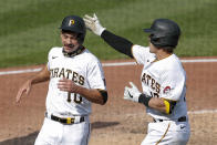 Pittsburgh Pirates' Bryan Reynolds (10) is greeted by John Ryan Murphy after he scored from second with the game winning run against the Minnesota Twins on a single by Kevin Newman in the ninth inning of a baseball game, Thursday, Aug. 6, 2020, in Pittsburgh. The Pirates won 6-5. (AP Photo/Keith Srakocic)