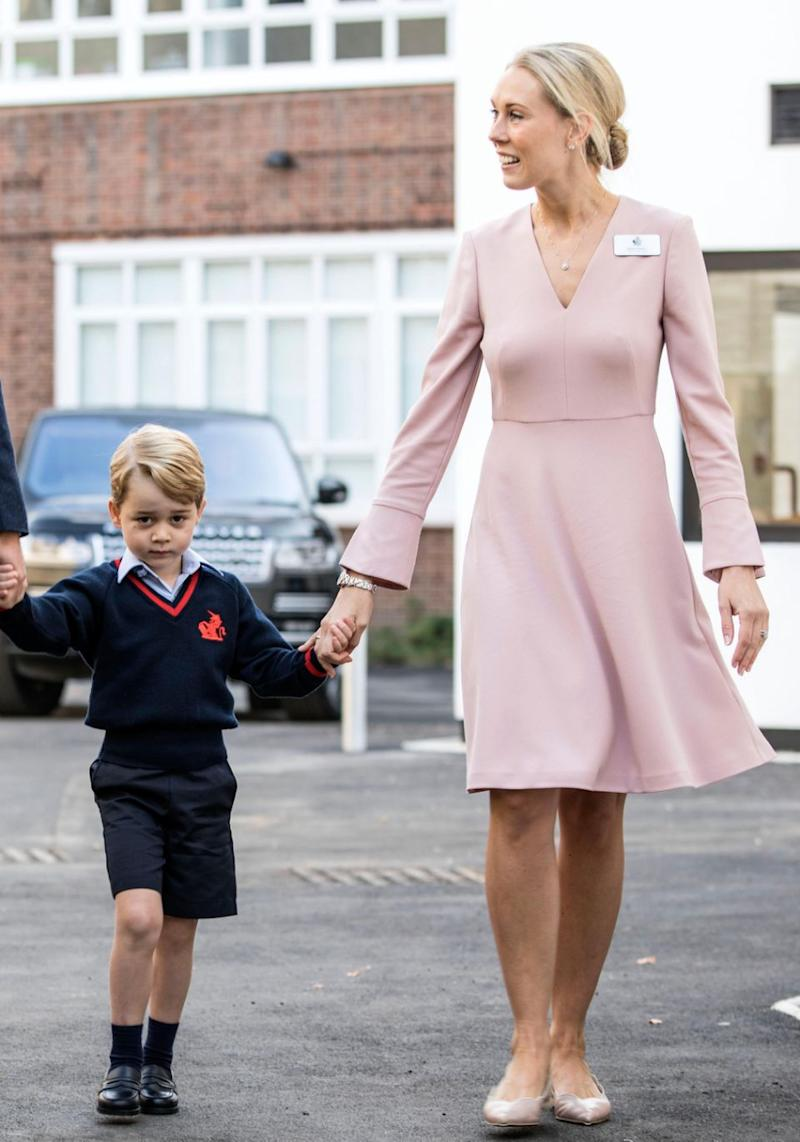 Prince George was greeted by the Head of the Lower School at Thomas's Battersea Ms Helen Haslem. Source: Getty