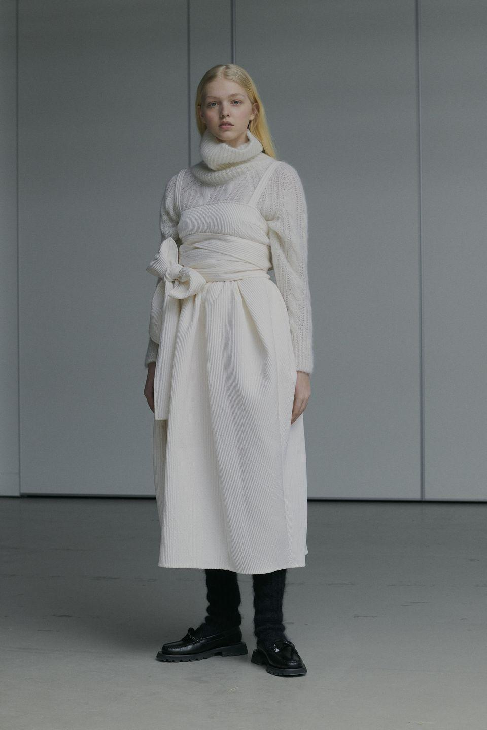 "<p>""For autumn/winter 2021, there was no moodboard pinned up in Cecilie Bahnsen's studio in Copenhagen,"" the brand explains. ""Instead her small team spent a month surrounded by the haute couture fabrics that have become synonymous with the label: quilted silks, floral fil-coupé, pleated organza and matelassé that falls on the body like the softest paper, light yet voluminous. Creating and developing new silhouettes and details on the stand.""</p><p>Focussing on these materials made for what Bahnsen hopes was a more intimate collection, doubling down on what she has become so well known for, but also expanding on elements she has only touched on in the past, including outerwear through a now ongoing partnership with Mackintosh, and she also explored layering more than ever before.</p><p>The collection was split into four sections, separated by colour, and this is how they will drop throughout the season, something which was mirrored in film 'The City' created as part of the presentation.</p><p>""The palette weaves through greys, blacks and blues to pale lemon with glistens of orange embroidery – moving out of the darkness into light.""</p><p><a href=""https://ceciliebahnsen.com/"" rel=""nofollow noopener"" target=""_blank"" data-ylk=""slk:Watch the film, and see the entire collection, here."" class=""link rapid-noclick-resp"">Watch the film, and see the entire collection, here.</a></p>"