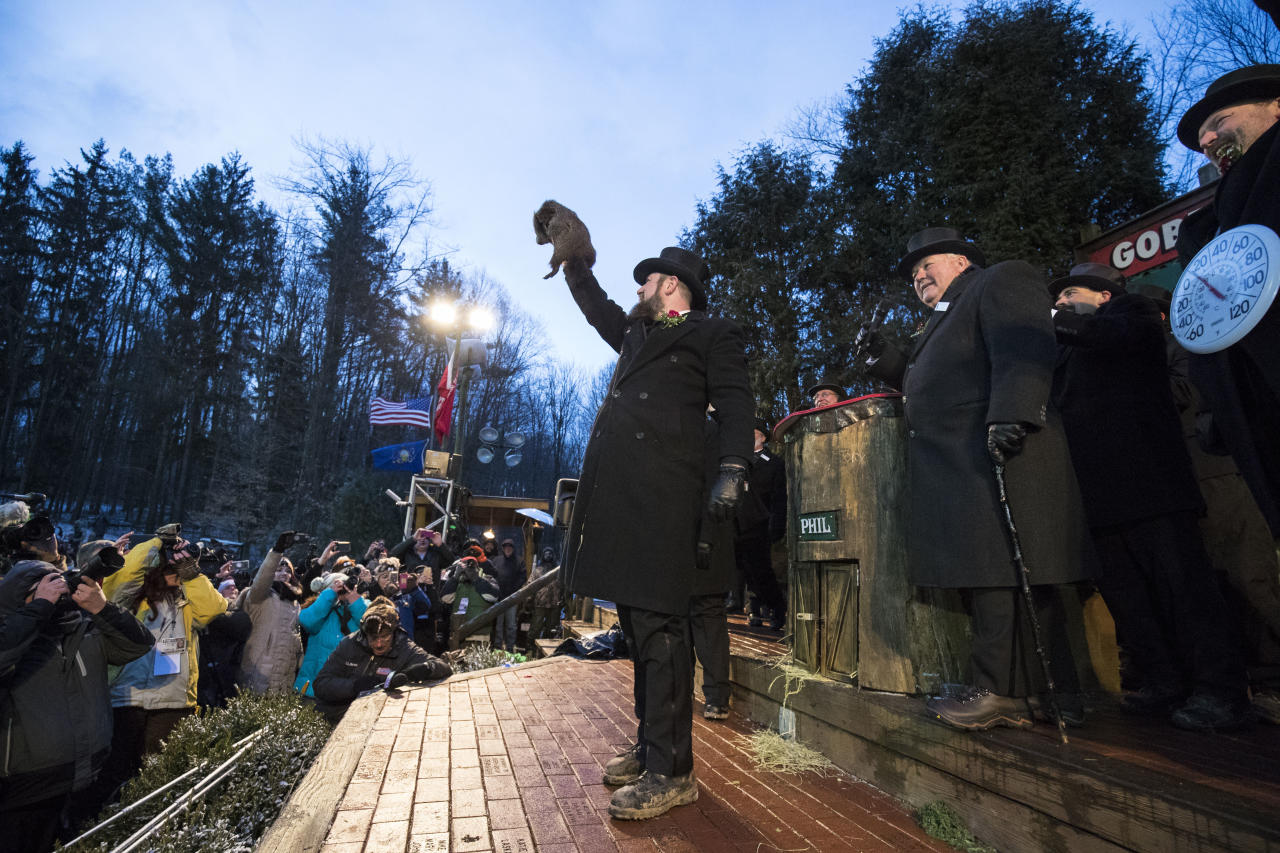 <p>Punxsutawney Phil is held up by his handler for the crowd to see during the ceremonies for Groundhog day on Feb. 2, 2018 in Punxsutawney, Pa. (Photo: Brett Carlsen/Getty Images) </p>