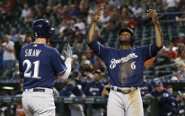 Milwaukee Brewers' Travis Shaw (21) celebrates his two-run home run against the Arizona Diamondbacks with teammate Lorenzo Cain (6) during the first inning of a baseball game Wednesday, May 16, 2018, in Phoenix. (AP Photo/Ross D. Franklin)