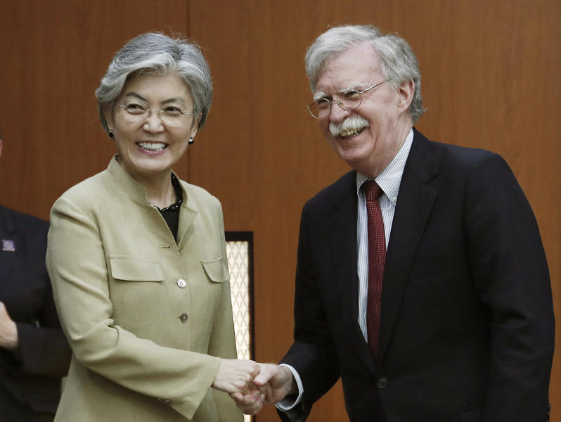South Korean Foreign Minister Kang Kyung-wha, left, shakes hands with U.S. National Security Advisor John Bolton during a meeting at the foreign ministry in Seoul, South Korea, Wednesday, July 24, 2019. (AP Photo/Ahn Young-joon, Pool)