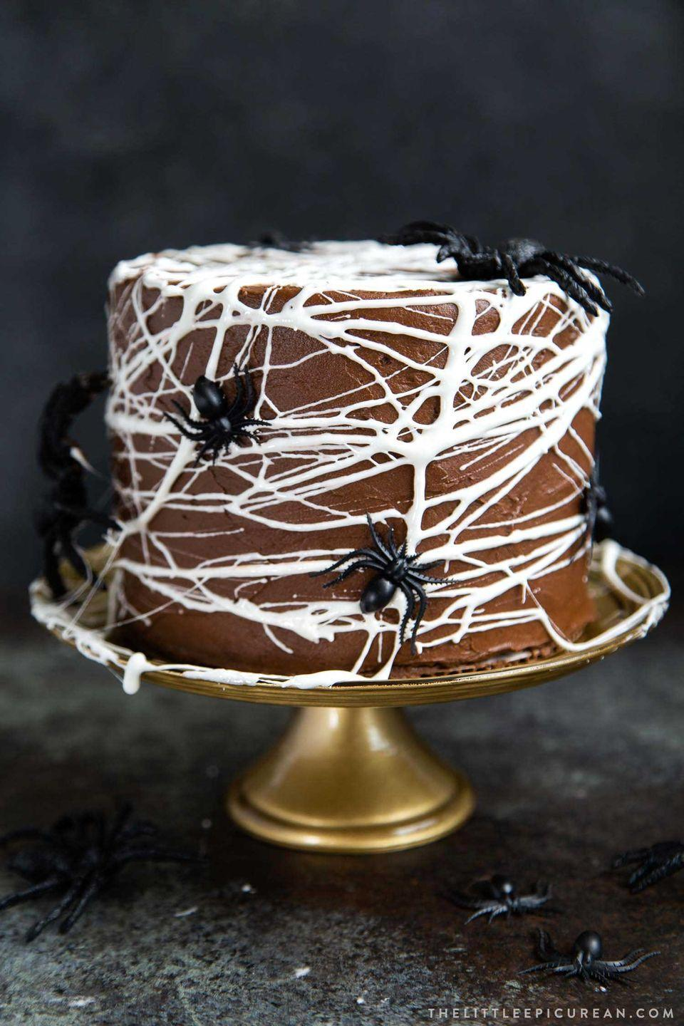 """<p>Three layers of rich chocolate cake get the Halloween treatment with drizzled melted marshmallow and some faux spiders. </p><p><a class=""""link rapid-noclick-resp"""" href=""""https://www.thelittleepicurean.com/2019/10/chocolate-spider-web-cake.html"""" rel=""""nofollow noopener"""" target=""""_blank"""" data-ylk=""""slk:GET THE RECIPE"""">GET THE RECIPE</a></p>"""