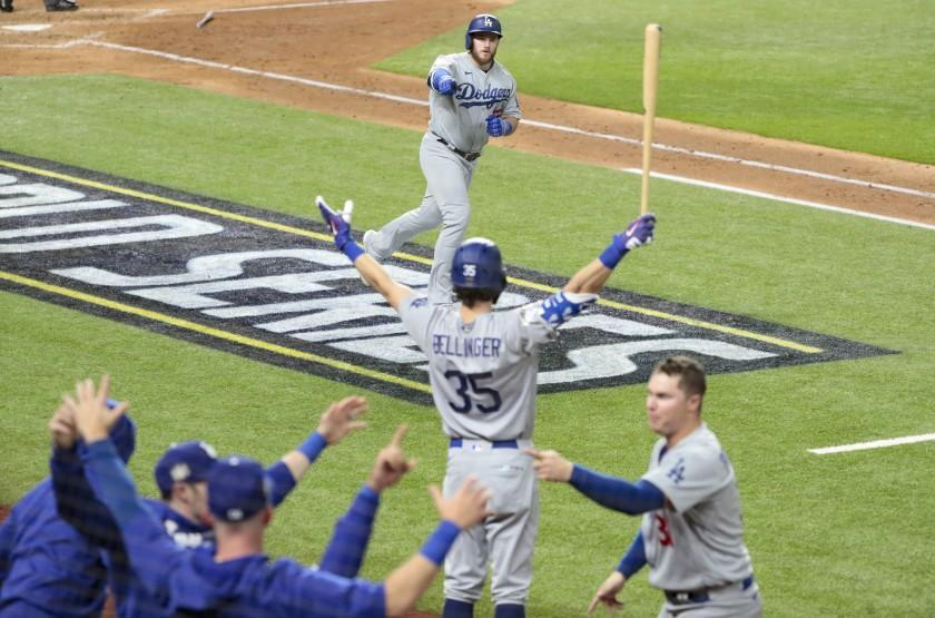 Arlington, Texas, Sunday, October 25, 2020 Max Muncy homers in the fifth inning in game five of the World Series at Globe Life Field. (Robert Gauthier/ Los Angeles Times)