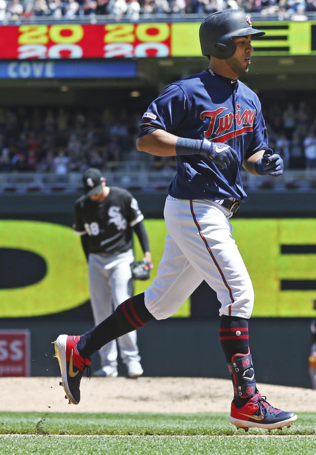 Minnesota Twins' Eddie Rosario jogs home on a three-run home run off Chicago White Sox pitcher Dylan Covey, back left, in the third inning of a baseball game Sunday, May 26, 2019, in Minneapolis. (AP Photo/Jim Mone)