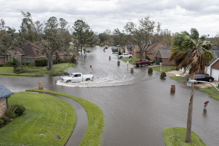 A truck drives through the flooded streets of Indigo Estates after Hurricane Ida moved through Monday, Aug. 30, 2021, in LaPlace, La. (Steve Helber/AP Photo)