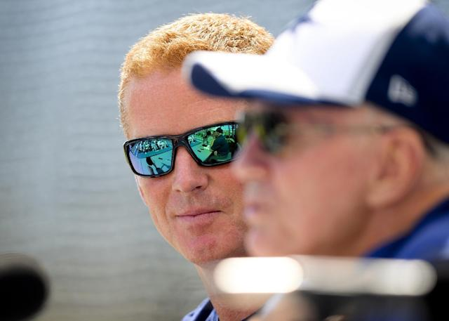 """Dallas Cowboys head coach Jason Garrett, left, looks over at owner Jerry Jones, right, who speaks at the """"State of the team"""" news conference during NFL football training camp on Wednesday, July 23, 2014, in Oxnard, Calif. (AP Photo/Gus Ruelas)"""