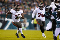 Tampa Bay Buccaneers Leonard Fournette (7) runs with the ball during the first half of an NFL football game against the Philadelphia Eagles on Thursday, Oct. 14, 2021, in Philadelphia. (AP Photo/Matt Rourke)
