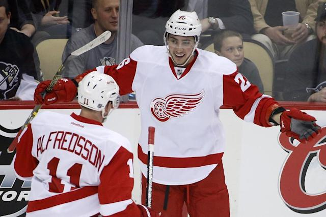 Detroit Red Wings' Tomas Jurco (26) celebrates his goal with Daniel Alfredsson (11) in the first period of an NHL hockey game against the Pittsburgh Penguins in Pittsburgh, Wednesday, April 9, 2014. (AP Photo/Gene J. Puskar)