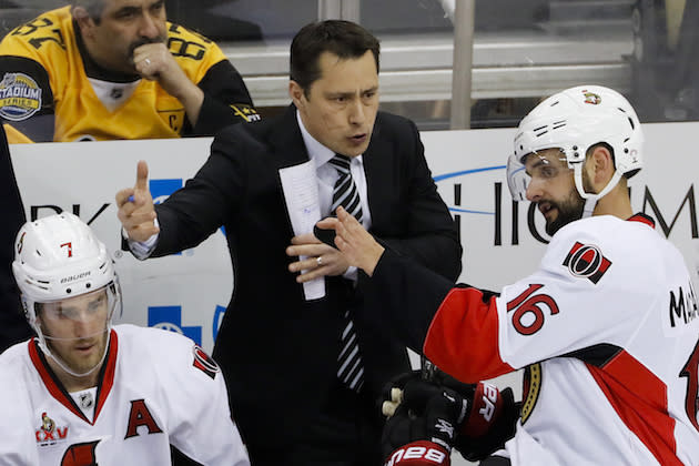 "<a class=""link rapid-noclick-resp"" href=""/nhl/teams/ott/"" data-ylk=""slk:Ottawa Senators"">Ottawa Senators</a> head coach Guy Boucher gives instruction to <a class=""link rapid-noclick-resp"" href=""/nhl/players/3701/"" data-ylk=""slk:Clarke MacArthur"">Clarke MacArthur</a> (16) during the third period of Game 1 of the Eastern Conference final in the NHL Stanley Cup hockey playoffs in Pittsburgh, Saturday, May 13, 2017. (AP Photo/Gene J. Puskar)"