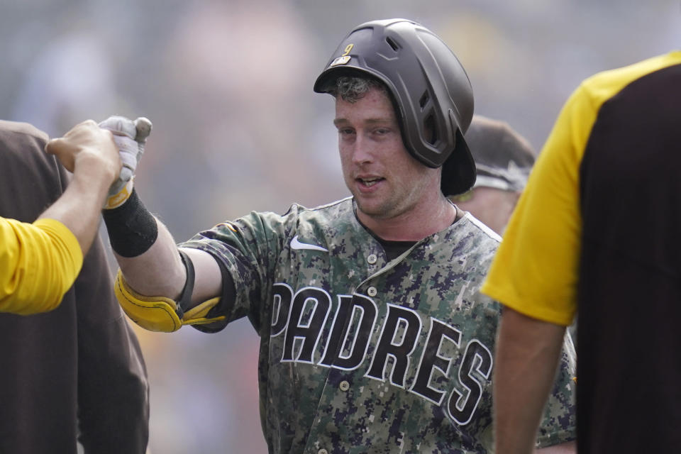 San Diego Padres' Jake Cronenworth reacts with teammates after hitting a walk-off home run during the ninth inning of a baseball game against the Houston Astros, Sunday, Sept. 5, 2021, in San Diego. The Padres won, 4-3. (AP Photo/Gregory Bull)