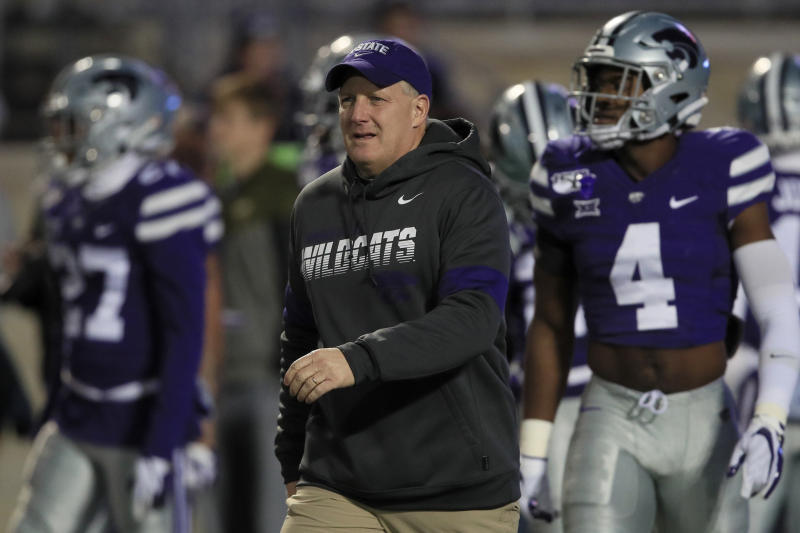 Kansas State head coach Chris Klieman watches warmups before an NCAA college football game against Iowa State in Manhattan, Kan., Saturday, Nov. 30, 2019. (AP Photo/Orlin Wagner)