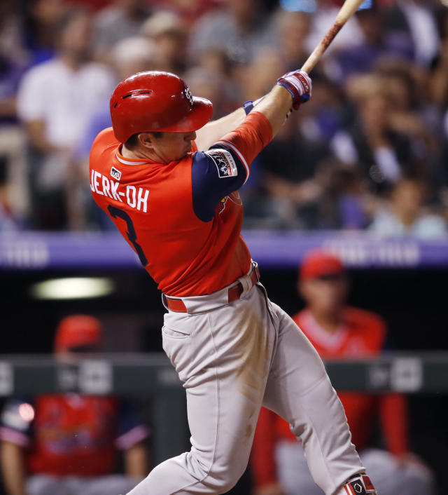 St. Louis Cardinals' Jedd Gyorko connects for an RBI-double off Colorado Rockies starting pitcher Antonio Senzatela in the fifth inning of a baseball game Friday, Aug. 24, 2018, in Denver. (AP Photo/David Zalubowski)