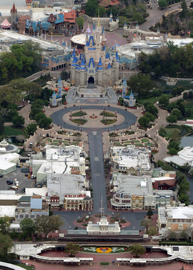 Cinderella Castle sits at the end of an empty Main Street at Disney's Magic Kingdom theme park after it closed in an effort to combat the spread of coronavirus disease (COVID-19), in an aerial view in Orlando, Florida, U.S. March 16, 2020. REUTERS/Gregg Newton