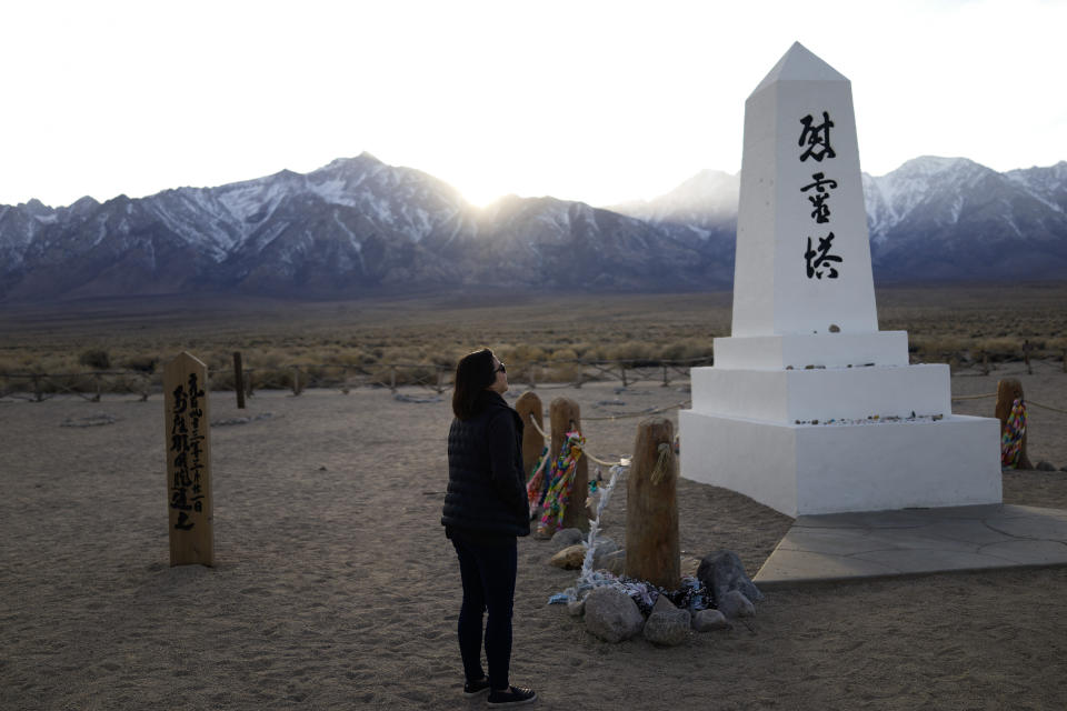 Lori Matsumura visits the cemetery at the Manzanar National Historic Site near Independence, Calif., Monday, Feb. 17, 2020. Matsumura's father and his family were among the more than 10,000 Japanese Americans imprisoned at the Manzanar War Relocation Center during World War II. Her grandfather, Giichi Matsumura, died when he left the camp to explore the nearby high Sierra in 1945. Hikers discovered his mountainside grave and unearthed the skeleton in 2019, leading authorities to retrieve the bones and return them to the Matsumura family. (AP Photo/Brian Melley)