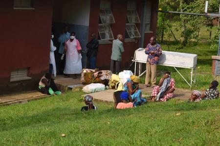 People are seen in the courtyard as Ugandan medical staff inspect the ebola preparedness facilities at the Bwera general hospital near the border with the Democratic Republic of Congo in Bwera