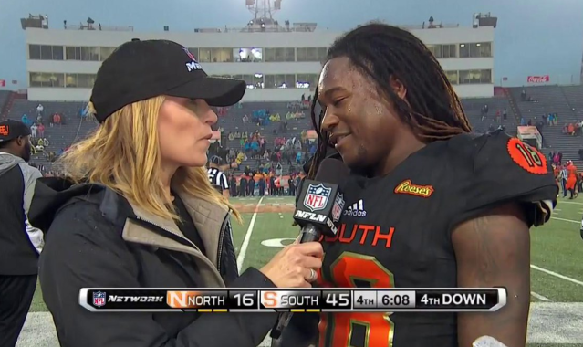 NFL Network sideline reporter Alex Flanagan interviews UCF's Shaquem Griffin while he's supposed to be on the field on punt team duty. (Getty)