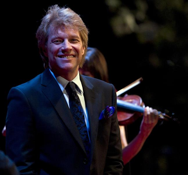 Musician Jon Bon Jovi performs at a campaign event for President Barack Obama at the Waldorf Astoria, Monday, June 4, 2012, in New York. (AP Photo/Carolyn Kaster)