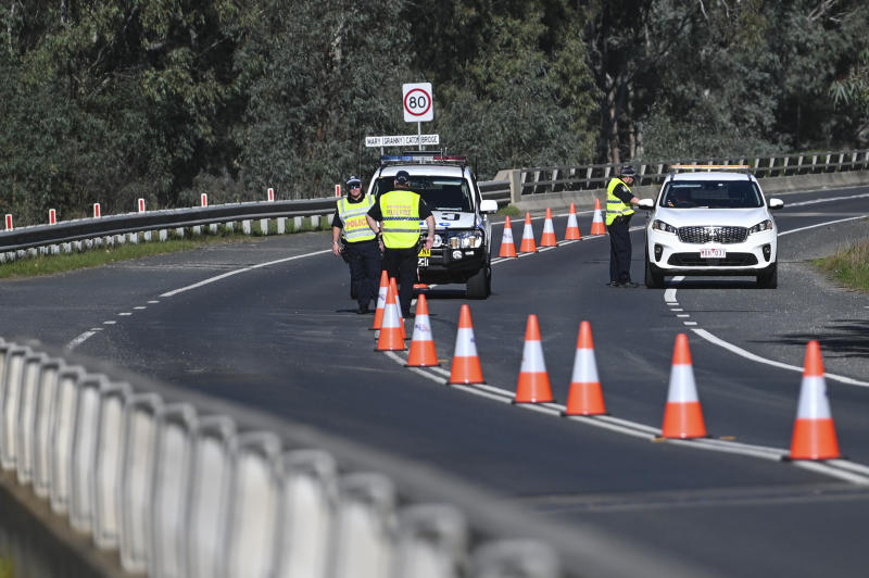 NSW Police officers are seen at the NSW-Victoria border crossing in Howlong near Albury.