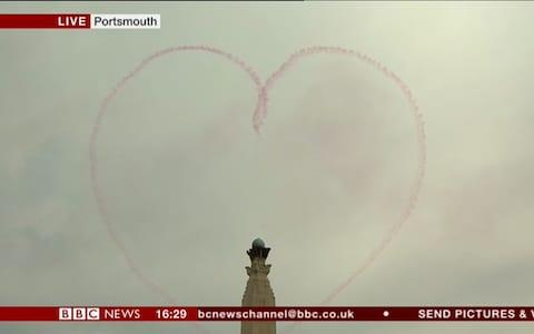 Red Arrow smoke trail in the shape of a heart - Credit: BBC