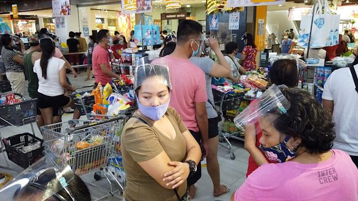 Residents in Legaspi, Albay province, in a busy supermarket on 31 October 2020