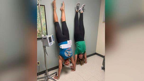 PHOTO: Lisa Fosnough, left, does a handstand with a friend during her chemotherapy treatment. (Courtesy Lisa Fosnough)