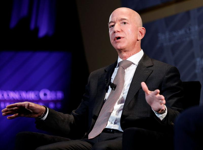 "Jeff Bezos, president and CEO of Amazon and owner of The Washington Post, speaks at the Economic Club of Washington DC's ""Milestone Celebration Dinner"" in Washington, U.S., September 13, 2018. REUTERS/Joshua Roberts"