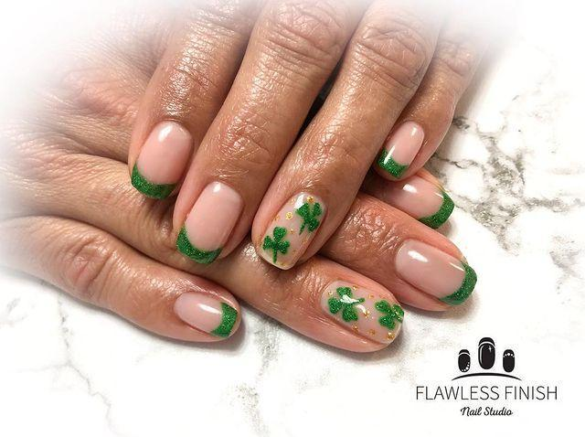 """<p>Give your classic French manicure an Irish twist with by replacing the traditional white tips with a glimmering green shade. </p><p><strong>RELATED: </strong><a href=""""https://www.goodhousekeeping.com/beauty/nails/g1267/french-manicure-ideas/"""" rel=""""nofollow noopener"""" target=""""_blank"""" data-ylk=""""slk:25 Fresh and Modern French Manicure Ideas"""" class=""""link rapid-noclick-resp"""">25 Fresh and Modern French Manicure Ideas</a></p><p><a href=""""https://www.instagram.com/p/BvLcY4_Bf_k/&hidecaption=true"""" rel=""""nofollow noopener"""" target=""""_blank"""" data-ylk=""""slk:See the original post on Instagram"""" class=""""link rapid-noclick-resp"""">See the original post on Instagram</a></p>"""