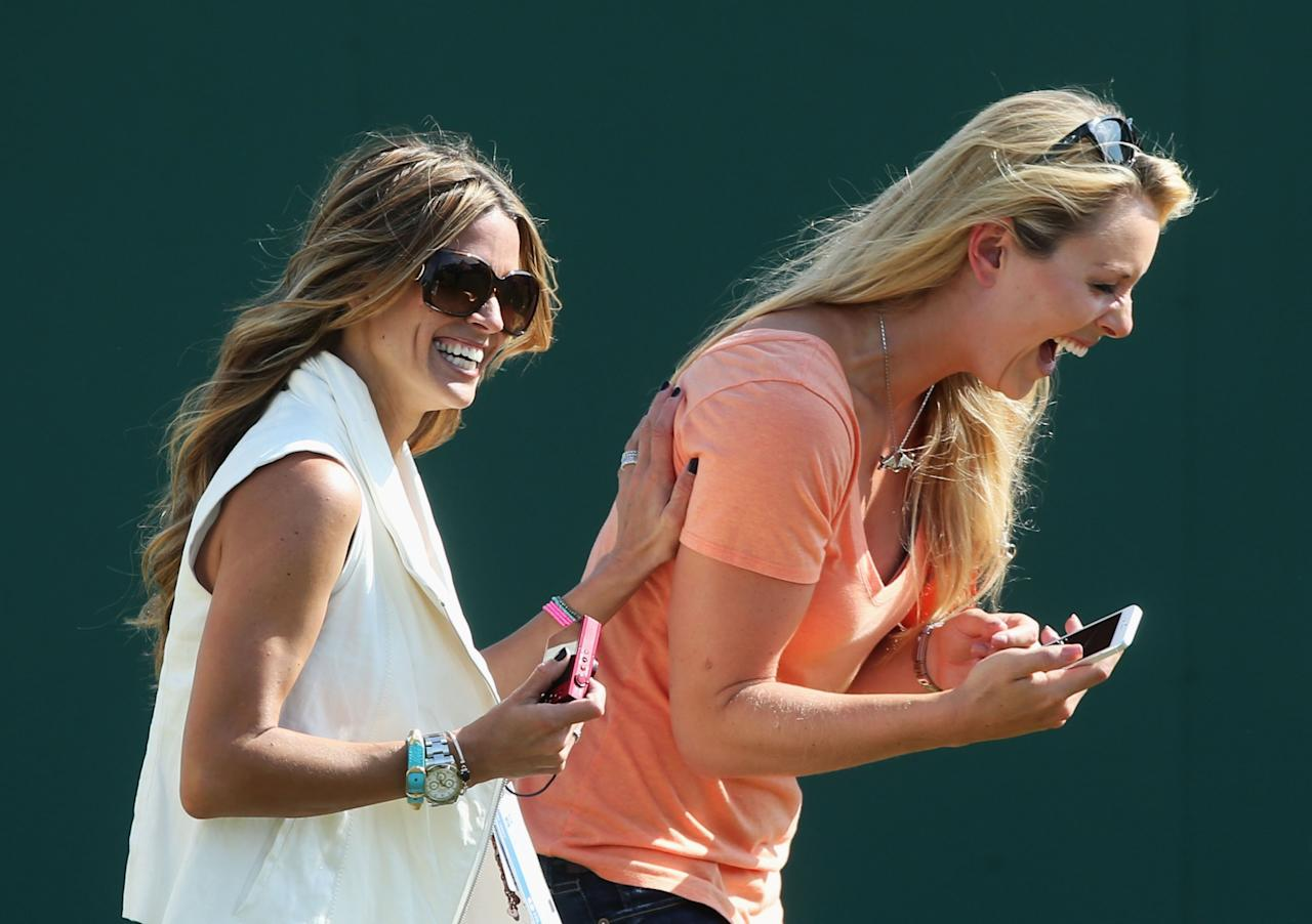 GULLANE, SCOTLAND - JULY 17: Nadine Moze and skier Lindsey Vonn laugh ahead of the 142nd Open Championship at Muirfield on July 17, 2013 in Gullane, Scotland. (Photo by Andrew Redington/Getty Images)