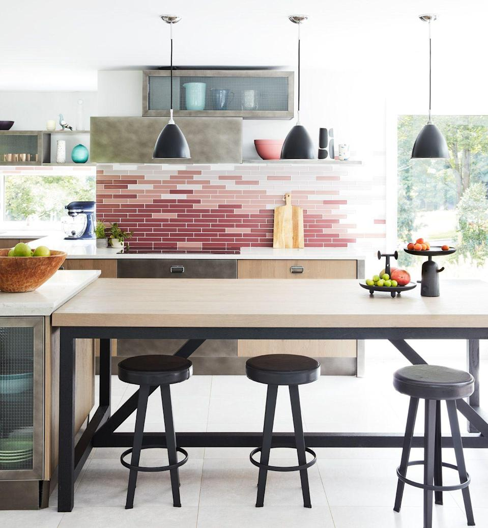 "<p>Don't leave that awkward foot between the upper cabinets and the ceiling! Adding cabinets up high—even above the hood, like Danielle Fennoy of <a href=""https://www.housebeautiful.com/design-inspiration/house-tours/a35950112/danielle-fennoy-long-island-contemporary-build/"" rel=""nofollow noopener"" target=""_blank"" data-ylk=""slk:Revamp Interior Design"" class=""link rapid-noclick-resp"">Revamp Interior Design</a> did—can help you store appliances, or the times in your kitchen you don't use as often creating more space for your counters.</p>"