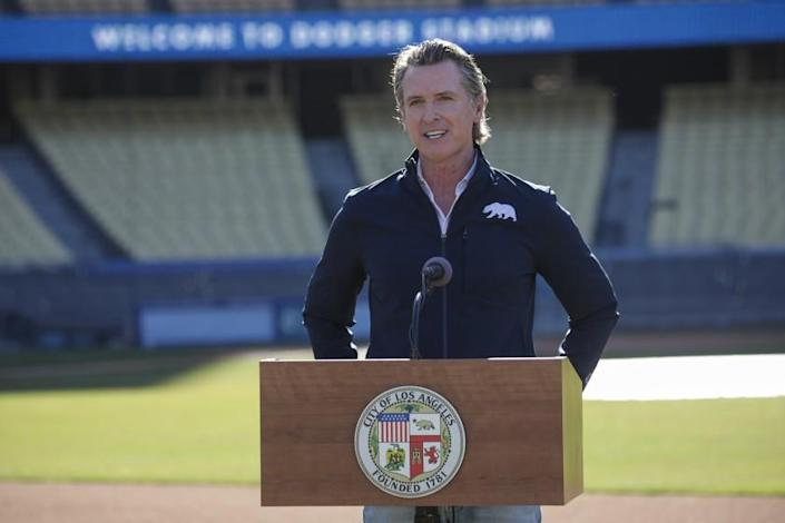 Los Angeles, CA - January 15: Governor Gavin Newsom addresses a press conference held at the launch of mass COVID-19 vaccination site at Dodger Stadium on Friday, Jan. 15, 2021 in Los Angeles, CA. (Irfan Khan / Los Angeles Times)