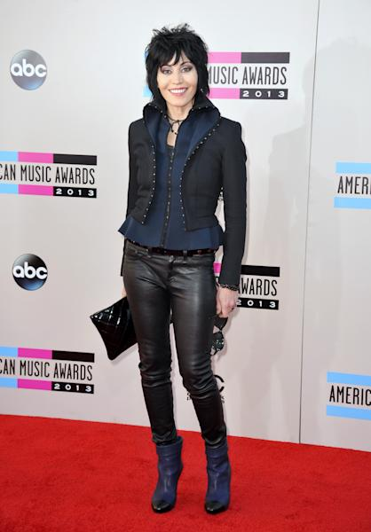 Joan Jett arrives at the American Music Awards at the Nokia Theatre L.A. Live on Sunday, Nov. 24, 2013, in Los Angeles. (Photo by Jordan Strauss/Invision/AP)