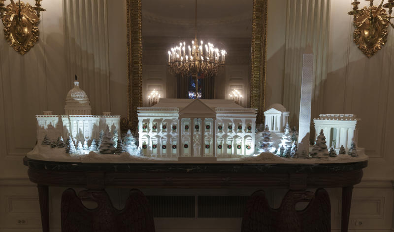 """The gingerbread house, showcasing the full expanse of the National Mall: the Capitol, the Lincoln Memorial, the Jefferson Memorial, the Washington Monument, and, the White House is seen in the State Dining Room during the 2018 Christmas Press Preview at the White House in Washington, Monday, Nov. 26, 2018. Christmas has arrived at the White House for 2018 as first lady Melania Trump unveiled the holiday decor. She designed the decor, which features a theme of """"American Treasures."""" (AP Photo/Carolyn Kaster)"""