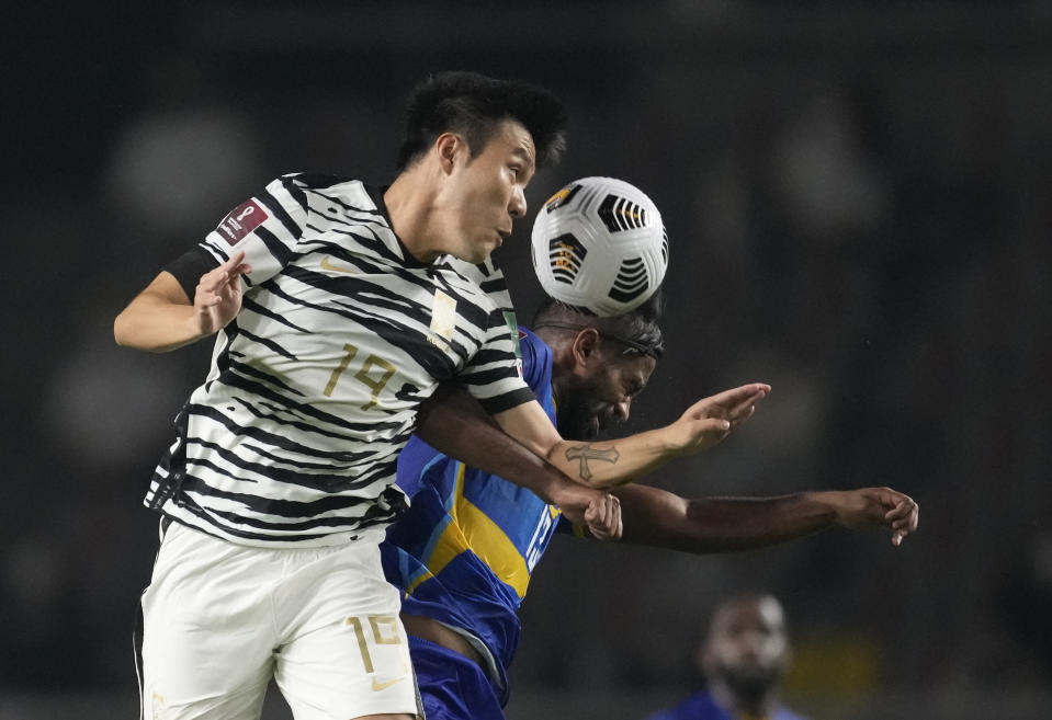South Korea's Kim Young-gwon, left, fights for the ball against Sri Lanka's Ahmed Waseem during their Asian zone Group H qualifying soccer match for the FIFA World Cup Qatar 2022 at Goyang stadium in Goyang, South Korea, Wednesday, June 9, 2021. (AP Photo/Lee Jin-man)