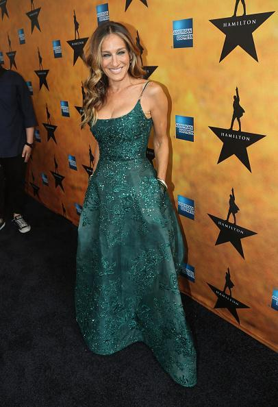 <p>Sarah Jessica Parker dressed to the nines for a night at the theater in an emerald green Elie Saab Couture gown. From the designer's Fall 2015 collection, the teal gown's intricately covered sequins and a stiched floral design.</p>