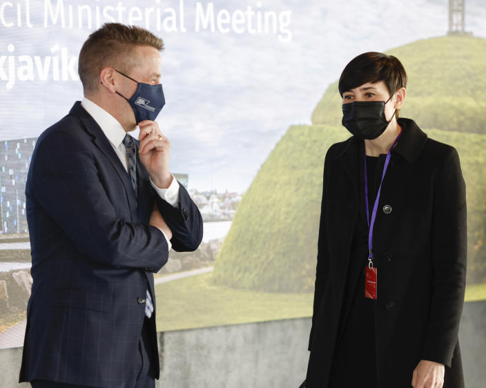 Norwegian Minister of Foreign Affairs Ine Marie Eriksen Søreide is greeted by Icelandic Minister of Foreign Affairs Gudlaugur Thor Thordarson as she arrives for the Arctic Council Ministerial Meeting in Reykjavik, Iceland, Thursday, May 20, 2021. (AP Photo/Brynjar Gunnarsson, Pool)