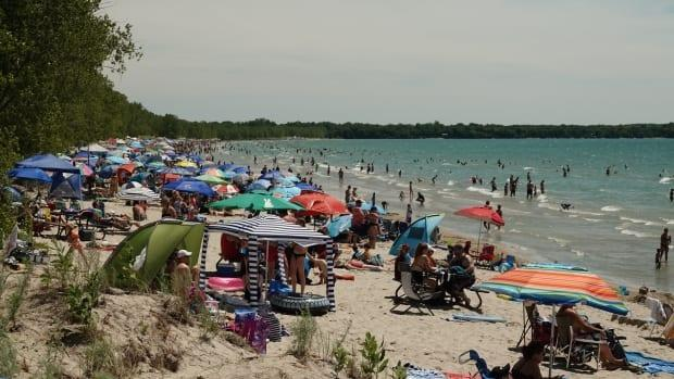 Outlet Beach at Sandbanks Provincial Park was taken off the list this year. The beach is shown here in 2019, when rising floodwaters forced staff to turn away visitors. Mattson says the park's water quality is excellent this year.