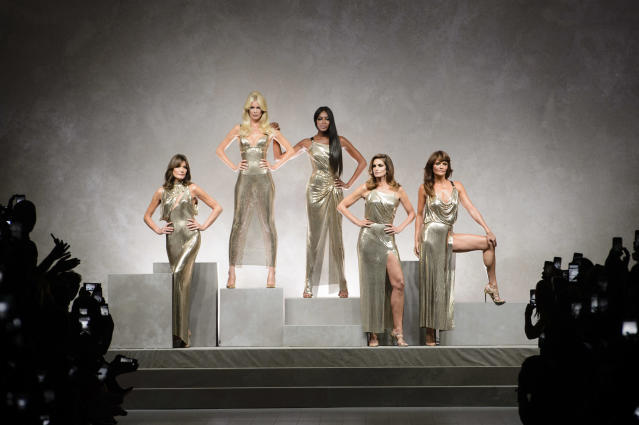 <p><i>From left: model Carla Bruni-Sarkozy, Claudia Schiffer, Naomi Campbell, Cindy Crawford and Helena Christensen in shimmering gold dresses from the SS18 Versace collection. (Photo: ImaxTree) </i></p>
