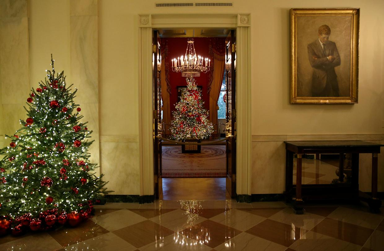 """The first lady Melania Trump's """"Be Best"""" campaign-themed Red Room can be seen from the Cross Hall during the 2018 Christmas Press Preview at the White House in Washington, D.C., Nov. 26, 2018. (Photo: Leah Millis/Reuters)"""