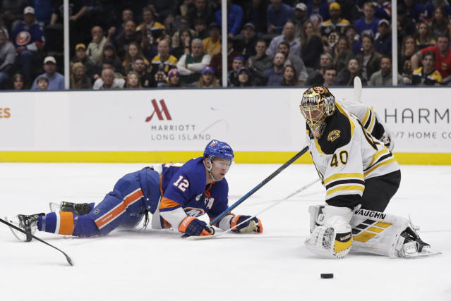 Boston Bruins goaltender Tuukka Rask (40) stops a shot on the goal by New York Islanders' Josh Bailey (12) during the second period of an NHL hockey game Tuesday, March 19, 2019, in Uniondale, N.Y. (AP Photo/Frank Franklin II)