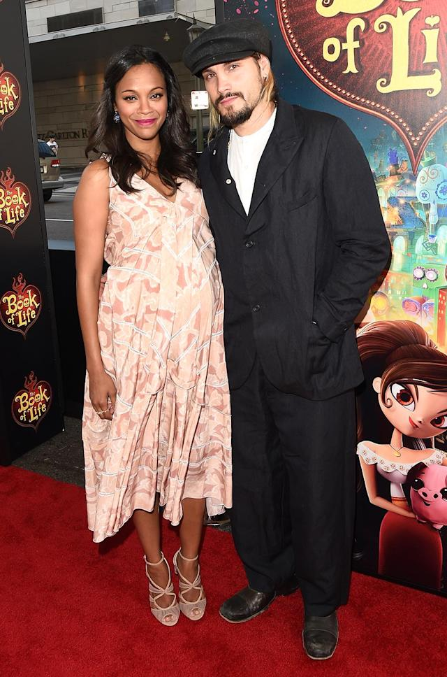 <p><em><em>Saldana married artist Marco Perego in 2013. The newlyweds and expectant parents attend the premiere of <em>The Book of Life</em> Oct. 12, 2014. (Photo: Jason Merritt/Getty Images) </em></em></p>