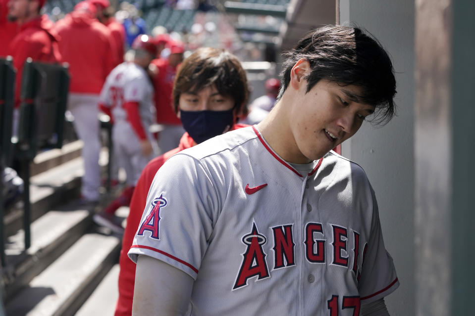 Los Angeles Angels Shohei Ohtani heads into the clubhouse at the end of the top of the first inning after being hit by a pitch but staying in the baseball game against the Seattle Mariners, Sunday, May 2, 2021, in Seattle. (AP Photo/Ted S. Warren)